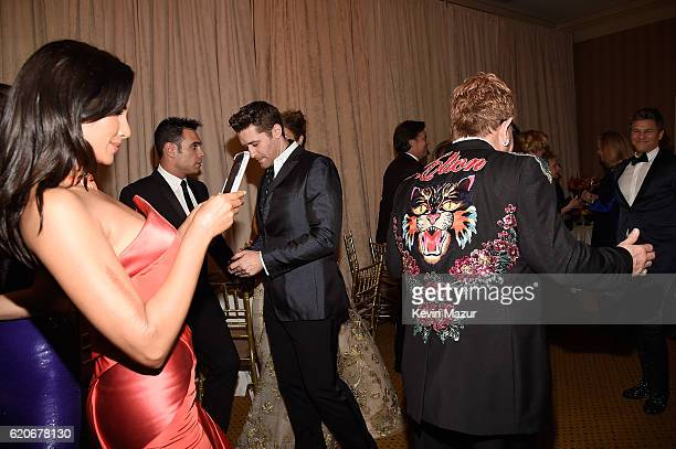 Padma Lakshmi takes a photo of Elton John's jacket at the 15th Annual Elton John AIDS Foundation An Enduring Vision Benefit at Cipriani Wall Street...