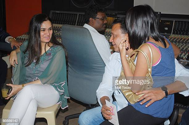 Padmini Kohlapuri chats up with Mithun Chakraborty at a recording studio in Mumbai on Friday November 27 2009