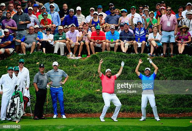 Padraig Harrington and Shane Lowry of Ireland react to a shot during the Par 3 Contest prior to the start of the 2015 Masters Tournament at Augusta...