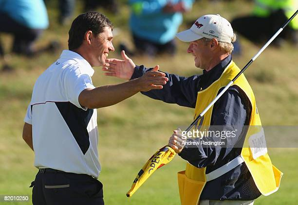 Padraig Harrington celebrates with caddie Ronan Flood on the 18th green after a 4 stroke victory during the final round of the 137th Open...