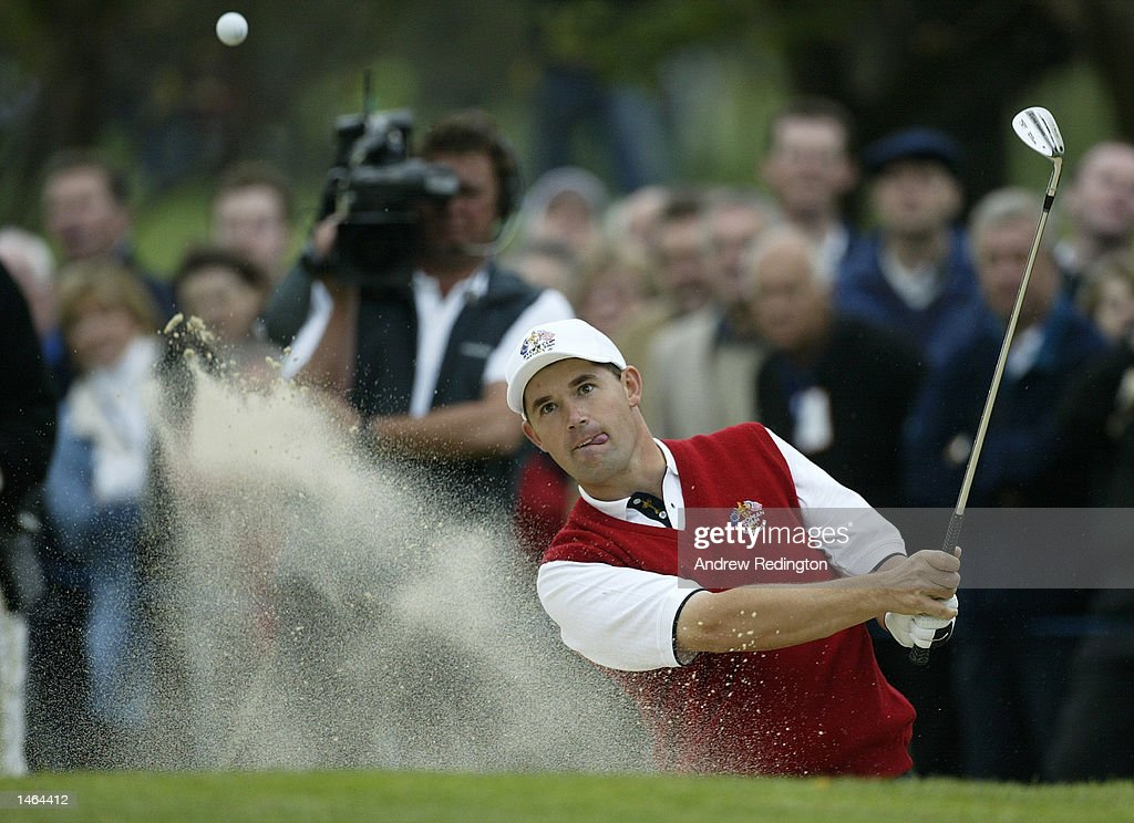 Padraig Harrington of Europe plays out from the bunker by the fourth green during the morning fourballs on the first day of the 34th Ryder Cup...