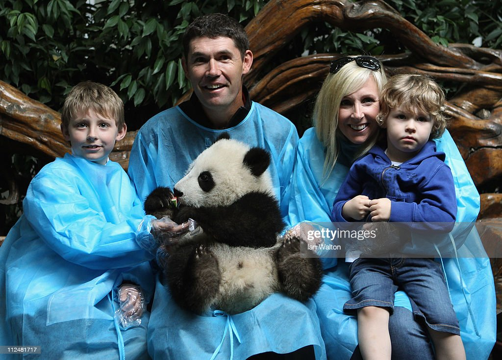 <a gi-track='captionPersonalityLinkClicked' href=/galleries/search?phrase=Padraig+Harrington&family=editorial&specificpeople=175865 ng-click='$event.stopPropagation()'>Padraig Harrington</a> of Ireland and his family, pose for photos with a baby Panda during a visit to the Chengdu Research Base of Giant Panda Breeding on April 19, 2011 in Chengdu, China.