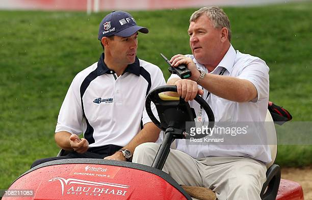 Padraig Harrington of Ireland arrives with European Tour senior referee Andy McFee for a press conference after being disqualified before his second...