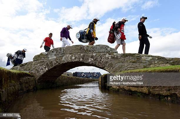Padraig Harrington of Ireland caddie Ronan Flood caddie Ken Herring Marc Warren of Scotland Wenchong Liang of China and caddie Koji Manabe walk of...