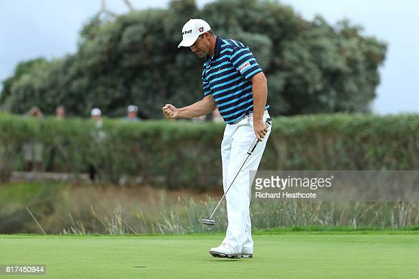Padraig Harrington of Ireland celebrates holing the winning putt on the 18th green during day four of the Portugal Masters at Victoria Clube de Golfe...