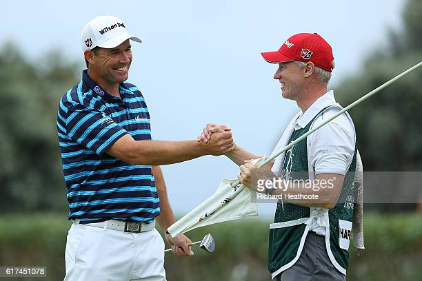 Padraig Harrington of Ireland celebrates victory on the 18th green with caddie Ronan Flood during day four of the Portugal Masters at Victoria Clube...