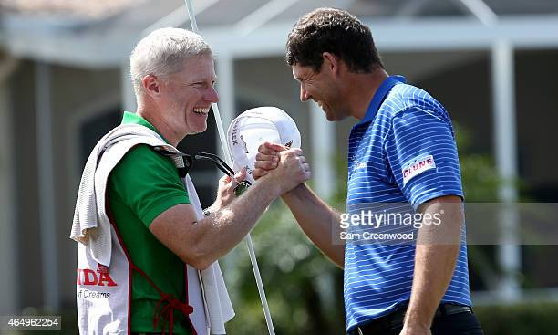 Padraig Harrington of Ireland celebrates with his caddie after winning on the second playoff hole during the continuation of the fourth round of The...