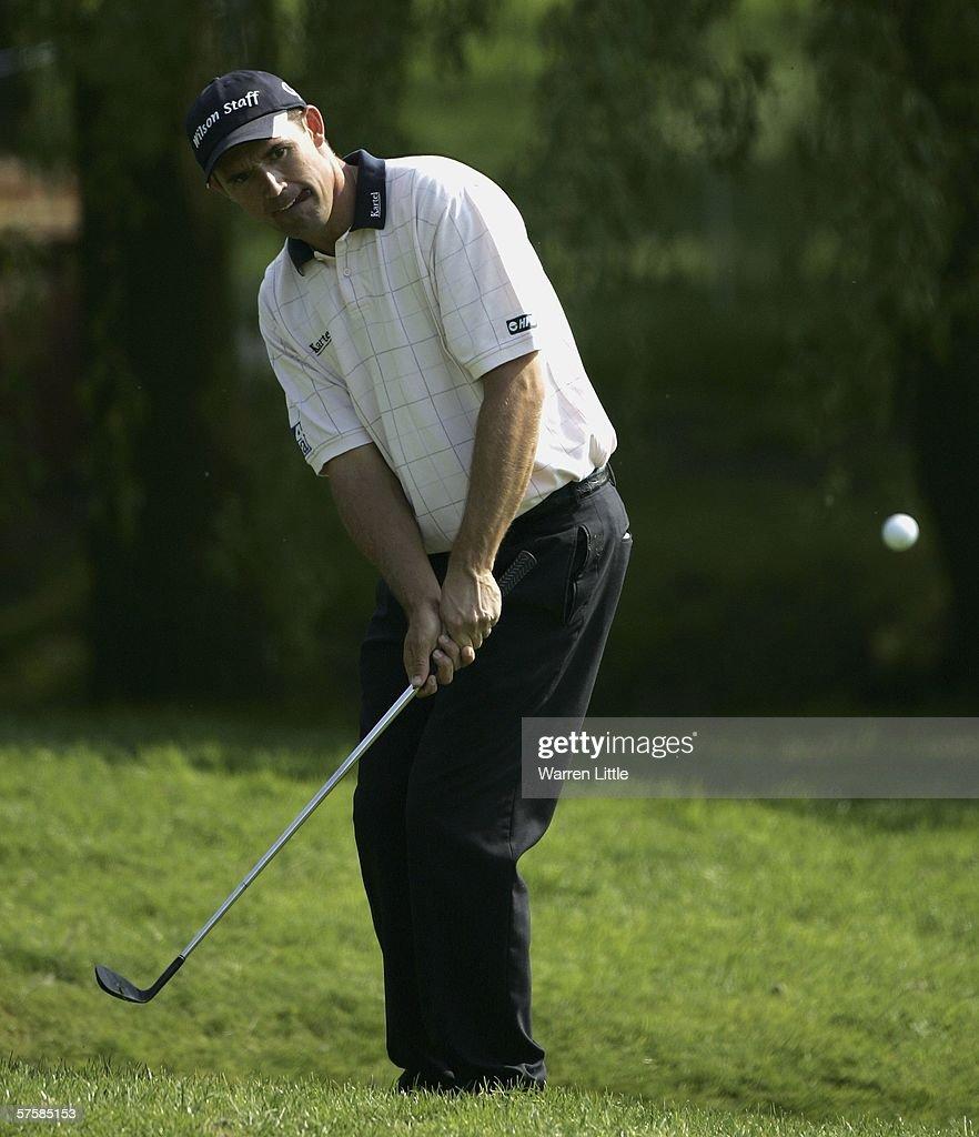 Padraig Harrington of Ireland chips onto the 12th green during the first round of the Quinn Direct British Masters on the Brabazon course at the De...