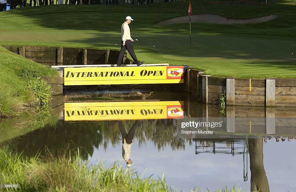 Padraig Harrington of Ireland crosses the bridge to the green on the par four 10th hole during the second round of the Benson Hedges International...