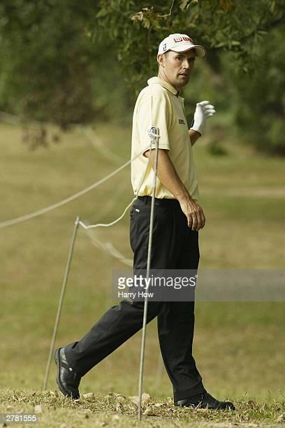 Padraig Harrington of Ireland crosses under a rope on the 12th hole at Hong Kong Golf Club on December 4 2003 in Hong Kong China
