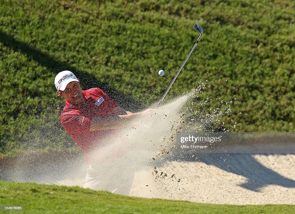 Padraig Harrington of Ireland hits a bunker shot on the 17th hole during the final round of the PGA Grand Slam of Golf at Port Royal Golf Course on October 24, 2012 in Southampton, Bermuda.