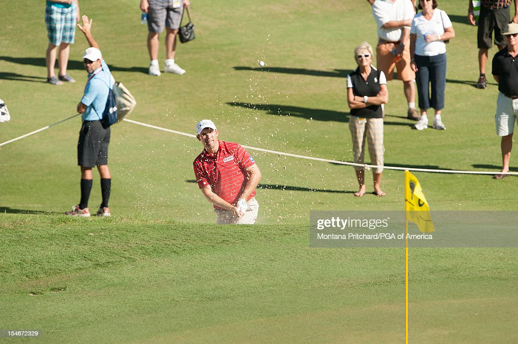 Padraig Harrington of Ireland hits a shot out of a bunker on number 6 during the final round of play at The Port Royal Golf Club for the 30th Grand Slam of Golf on October, 24, 2012 in Southampton, Bermuda.