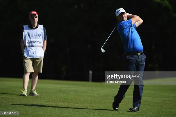 Padraig Harrington of Ireland hits an approach shot during the BMW PGA Championship ProAm at Wentworth on May 24 2017 in Virginia Water England