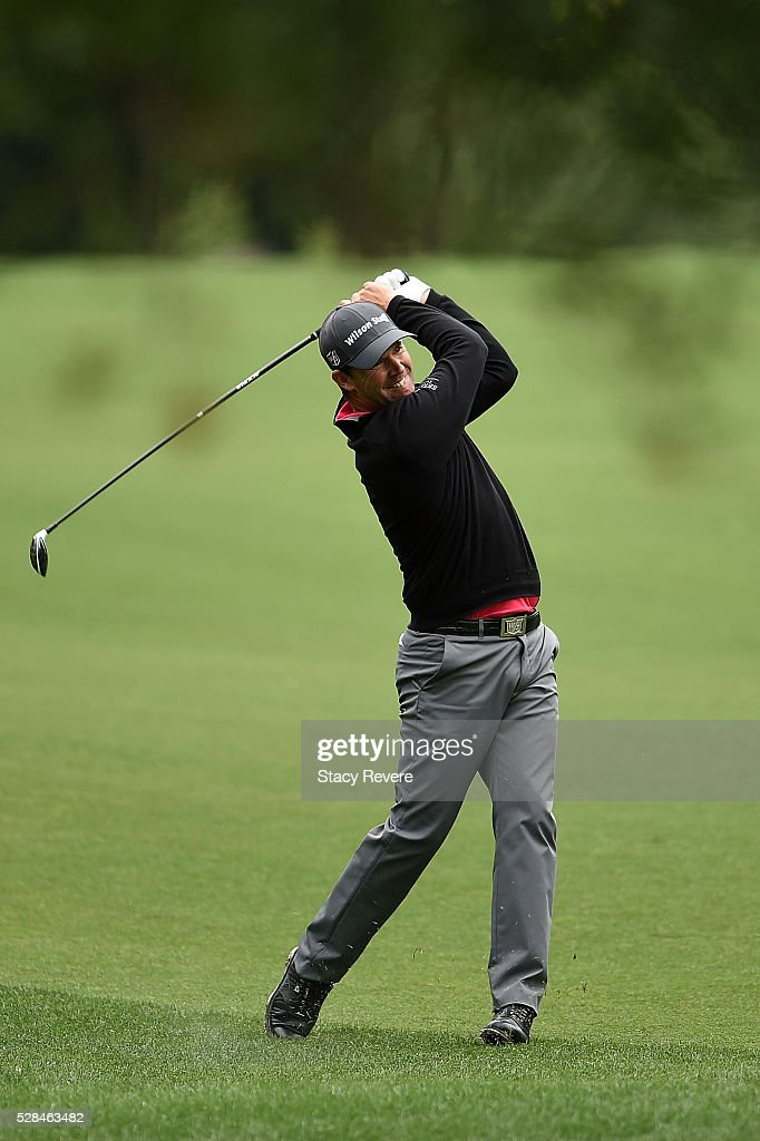Padraig Harrington of Ireland hits his approach shot on the fifth hole during the first round of the Wells Fargo Championship at Quail Hollow on May 5, 2016 in Charlotte, North Carolina.