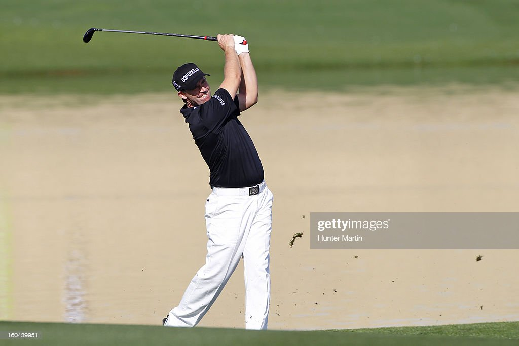 Padraig Harrington of Ireland hits his second shot on the 15th hole during the first round of the Waste Management Phoenix Open at TPC Scottsdale on January 31, 2013 in Scottsdale, Arizona.