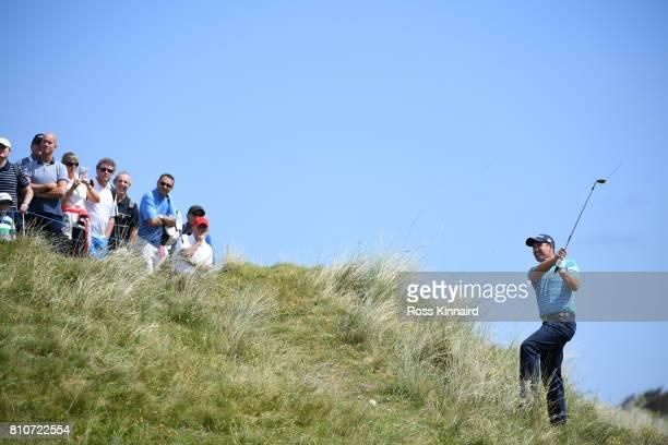 Padraig Harrington of Ireland hits his second shot on the 4th hole during day three of the Dubai Duty Free Irish Open at Portstewart Golf Club on...