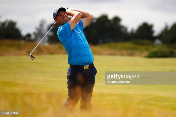 Padraig Harrington of Ireland hits his second shot on the 9th hole during day two of the AAM Scottish Open at Dundonald Links Golf Course on July 14...