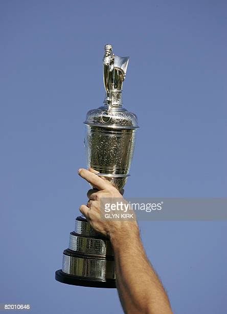 Padraig Harrington of Ireland holds the Claret Jug after winning the The Open golf tournament at Royal Birkdale in Southport in northwest England on...