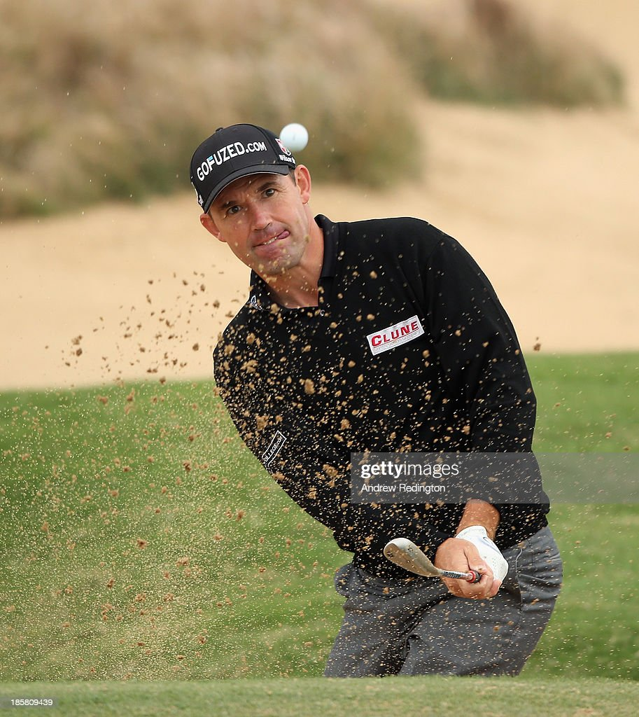 <a gi-track='captionPersonalityLinkClicked' href=/galleries/search?phrase=Padraig+Harrington&family=editorial&specificpeople=175865 ng-click='$event.stopPropagation()'>Padraig Harrington</a> of Ireland in action during the second round of the BMW Masters at Lake Malaren Golf Club on October 25, 2013 in Shanghai, China.