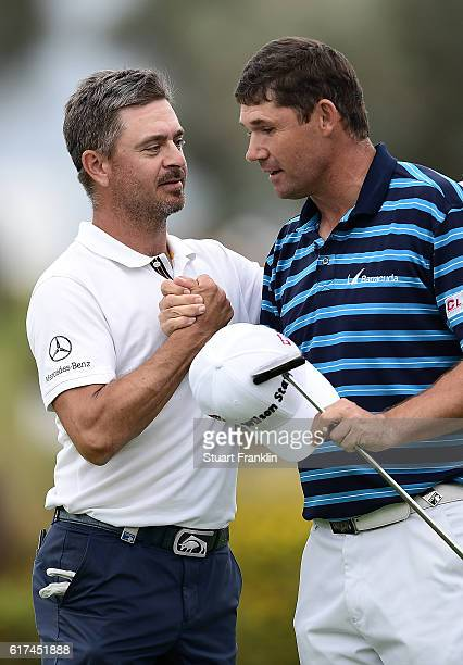 Padraig Harrington of Ireland is congratulated by Mikko Korhonen of Finland after holing the winning putt on the 18th green during day four of the...