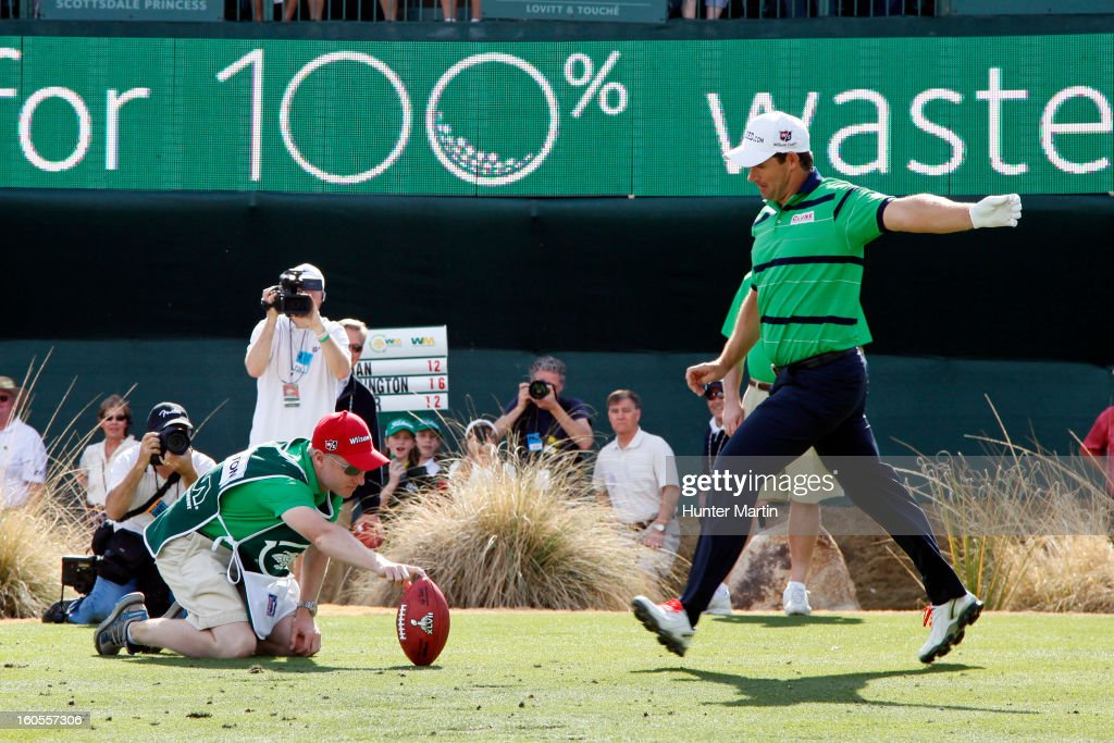 Padraig Harrington of Ireland kicks a football into the stands on the 16th hole during the third round of the Waste Management Phoenix Open at TPC Scottsdale on February 2, 2013 in Scottsdale, Arizona.