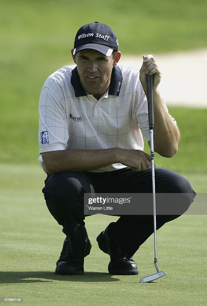 Padraig Harrington of Ireland lines up a putt on the 14th green during the first round of the Quinn Direct British Masters on the Brabazon course at...