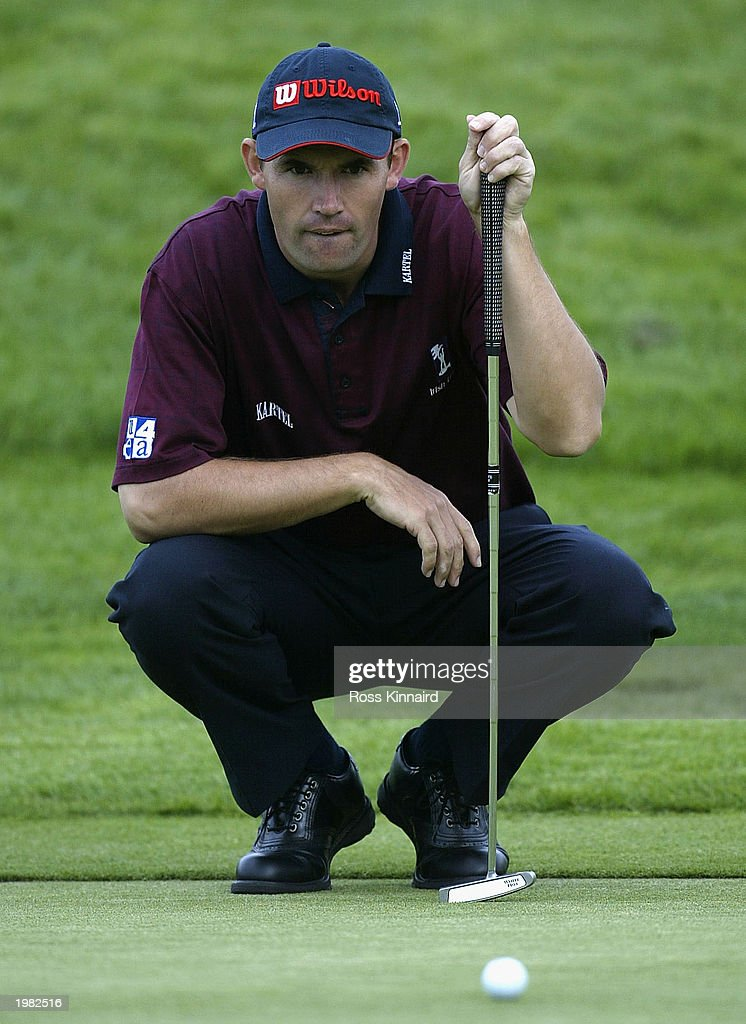 Padraig Harrington of Ireland lines up a putt on the 14th hole during the first round of the Benson and Hedges International Open on the Barbazon...