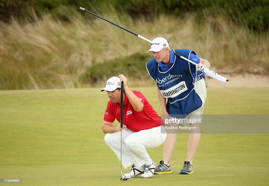 <a gi-track='captionPersonalityLinkClicked' href=/galleries/search?phrase=Padraig+Harrington&family=editorial&specificpeople=175865 ng-click='$event.stopPropagation()'>Padraig Harrington</a> of Ireland lines up a putt with caddie Ronan Flood during the second round of the Aberdeen Asset Management Scottish Open at Castle Stuart Golf Links on July 12, 2013 in Inverness, Scotland.
