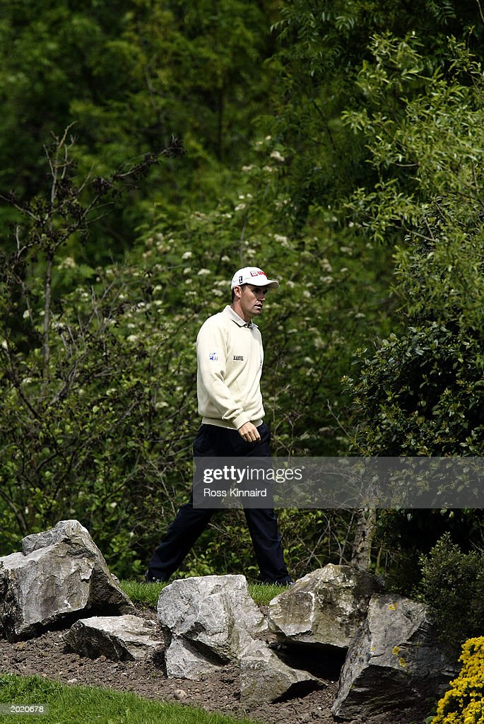 Padraig Harrington of Ireland looking for a place to play from on the par four 8th hole during the second round of the Benson and Hedges...