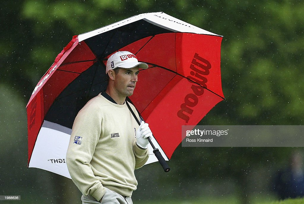Padraig Harrington of Ireland on the par four 4th hole during the third round of the Benson and Hedges International Open on the Barbazon course at...
