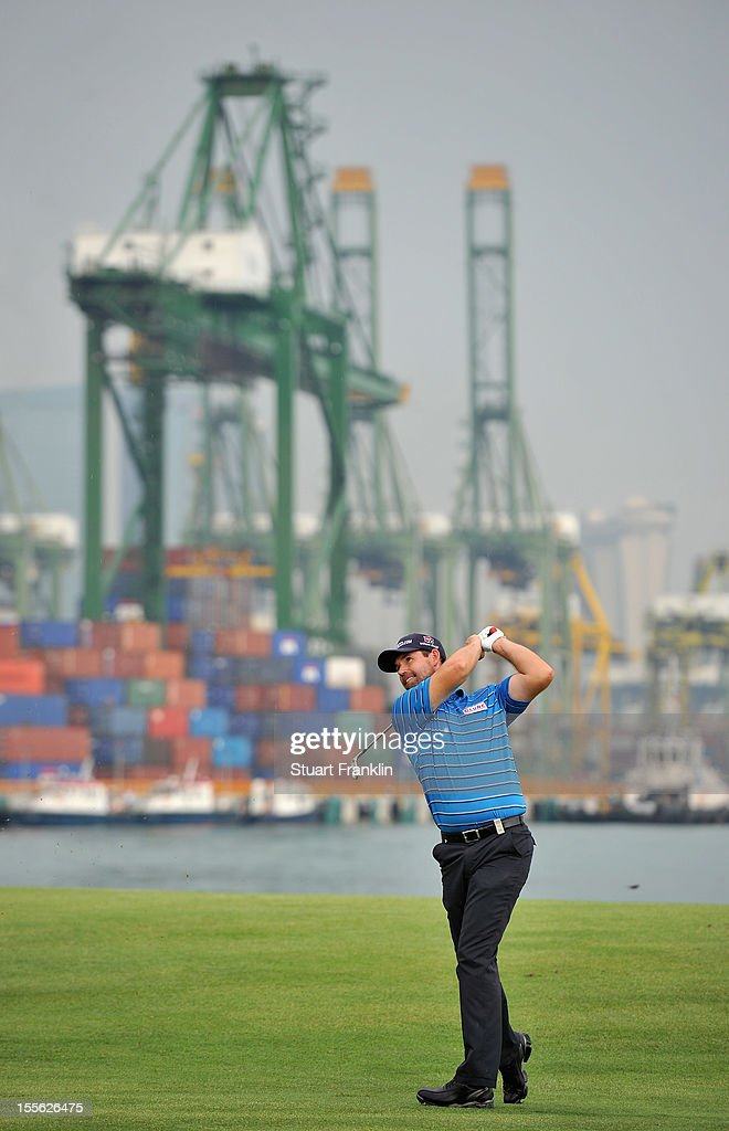 <a gi-track='captionPersonalityLinkClicked' href=/galleries/search?phrase=Padraig+Harrington&family=editorial&specificpeople=175865 ng-click='$event.stopPropagation()'>Padraig Harrington</a> of Ireland plays a shot in practice prior to the start of the Barclays Singapore Open at at the Sentosa Golf Club on November 6, 2012 in Singapore.