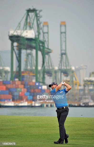 Padraig Harrington of Ireland plays a shot in practice prior to the start of the Barclays Singapore Open at at the Sentosa Golf Club on November 6...