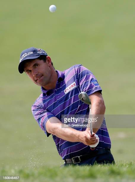 Padraig Harrington of Ireland plays a shot on the pratcice ground after playing the First Round of The Barclays on the Black Course at Bethpage State...