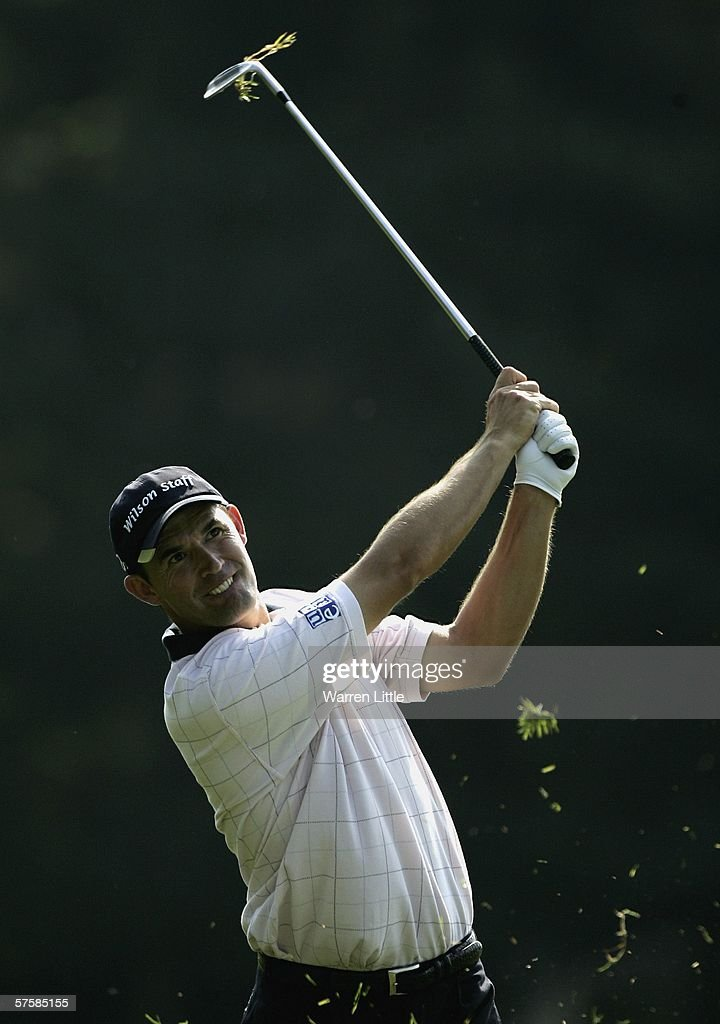 Padraig Harrington of Ireland plays his second shot into the 13th green during the first round of the Quinn Direct British Masters on the Brabazon...