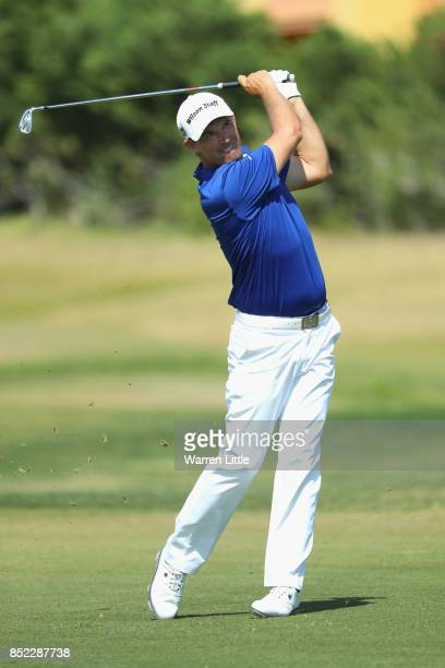 Padraig Harrington of Ireland plays his second shot into the ninth green during the Portugal Masters at the Oceanico Victoria Golf Club on September...