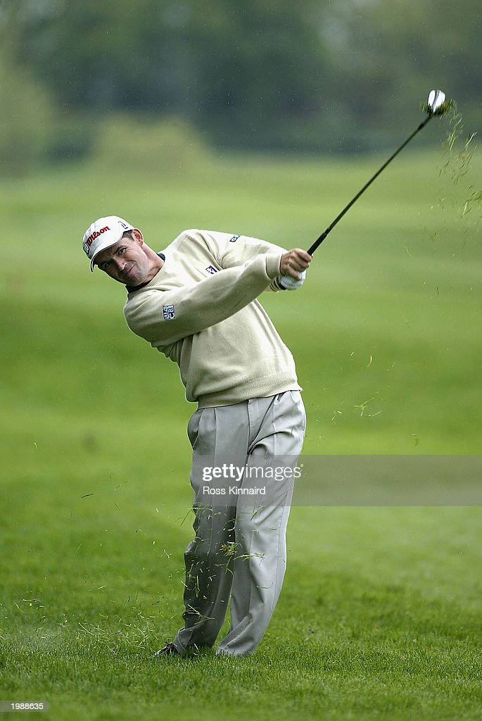Padraig Harrington of Ireland plays his second shot on the par four 4th hole during the third round of the Benson and Hedges International Open on...