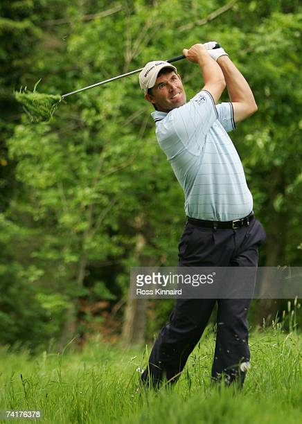 Padraig Harrington of Ireland plays his second shot on the par four 17th hole during the first round of the Irish Open on May 17 2007 at the Adare...