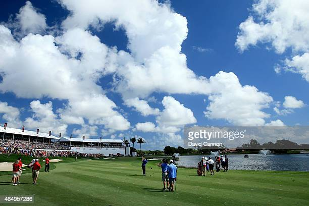 Padraig Harrington of Ireland plays his shot from the 18th fairway during the continuation of the fourth round of The Honda Classic at PGA National...