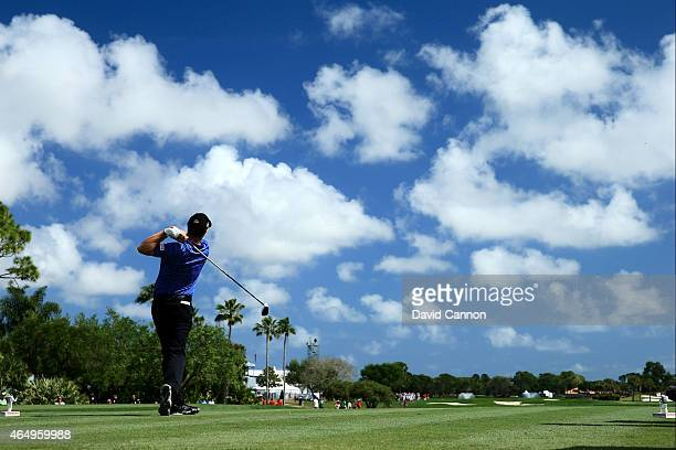 Padraig Harrington of Ireland plays his tee shot on the first playoff hole during the continuation of the fourth round of The Honda Classic at PGA...