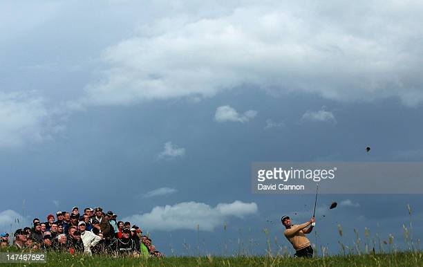 Padraig Harrington of Ireland plays his third shot at the 17th hole during the third round of the 2012 Irish Open held on the Dunluce Links at Royal...