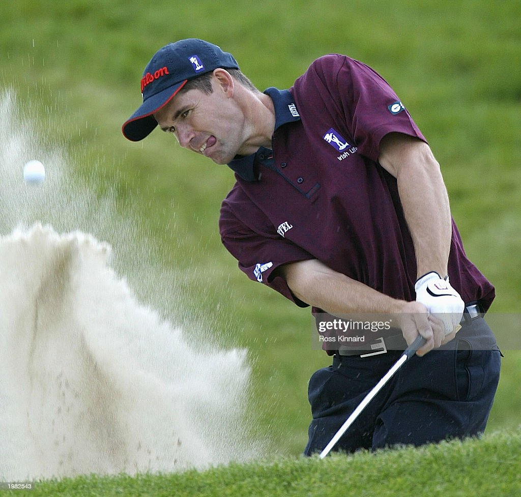 Padraig Harrington of Ireland plays his third shot on the par five 17th hole during the first round of the Benson and Hedges International Open on...