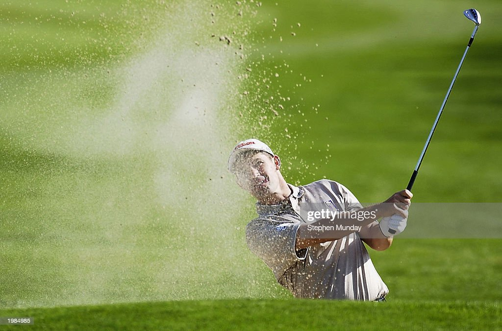 Padraig Harrington of Ireland plays his third shot on the par five 15th hole during the second round of the Benson Hedges International Open on the...