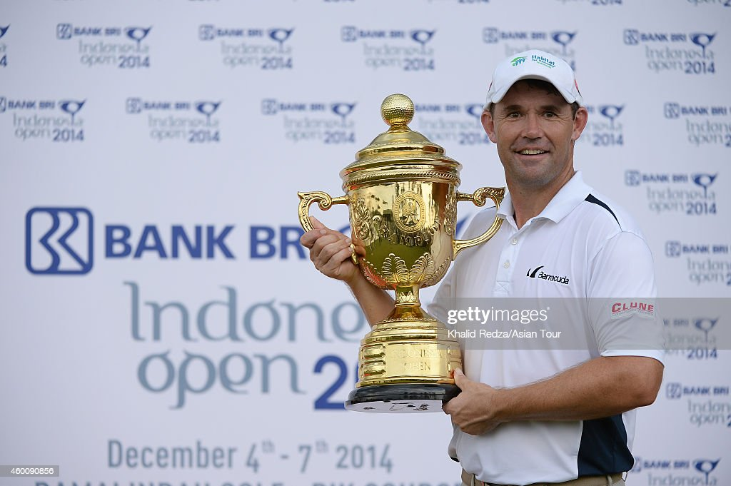 Padraig Harrington of Ireland poses with the trophy after winning during round four of the Indonesia Open at Damai Indah Golf, Pantai Indah Kapuk Course on December 7, 2014 in Jakarta, Indonesia.