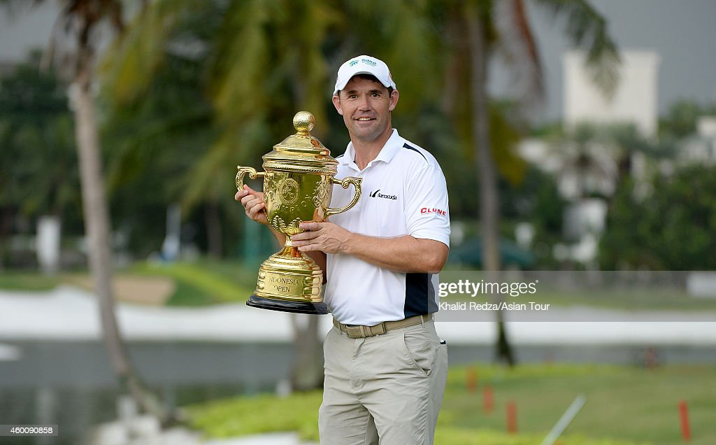 <a gi-track='captionPersonalityLinkClicked' href=/galleries/search?phrase=Padraig+Harrington&family=editorial&specificpeople=175865 ng-click='$event.stopPropagation()'>Padraig Harrington</a> of Ireland poses with the trophy after winning during round four of the Indonesia Open at Damai Indah Golf, Pantai Indah Kapuk Course on December 7, 2014 in Jakarta, Indonesia.