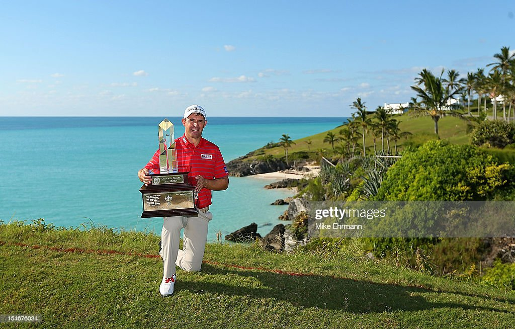 <a gi-track='captionPersonalityLinkClicked' href=/galleries/search?phrase=Padraig+Harrington&family=editorial&specificpeople=175865 ng-click='$event.stopPropagation()'>Padraig Harrington</a> of Ireland poses with the trophy after winning the PGA Grand Slam of Golf at Port Royal Golf Course on October 24, 2012 in Southampton, Bermuda.