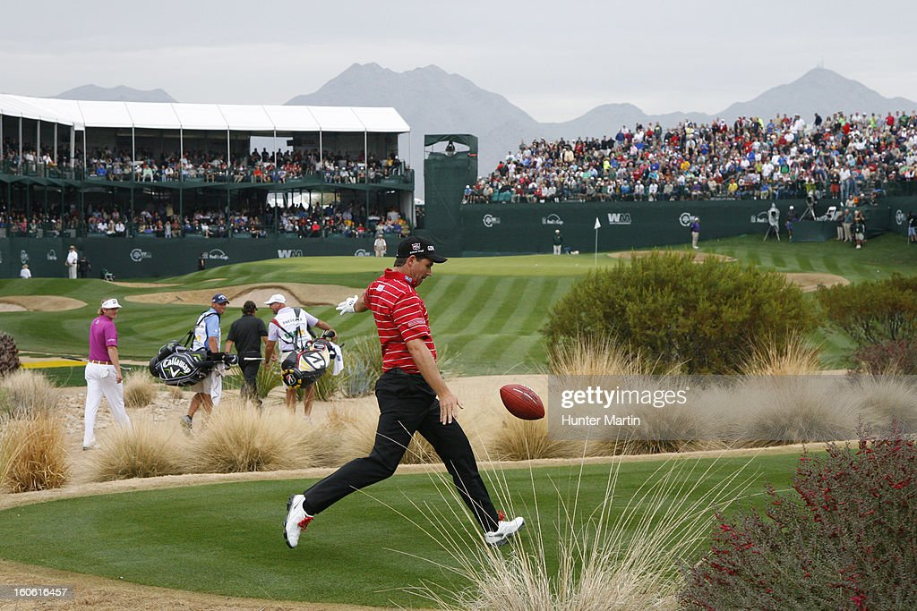 Padraig Harrington of Ireland punts a football into the grandstands on the 16th hole during the final round of the Waste Management Phoenix Open at TPC Scottsdale on February 3, 2013 in Scottsdale, Arizona.