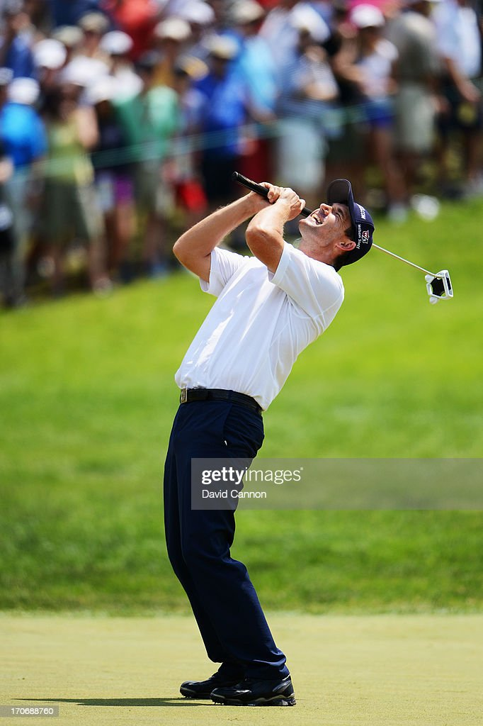 Padraig Harrington of Ireland reacts to a missed putt for biridie on the fourth hole during Round Three of the 113th U.S. Open at Merion Golf Club on June 15, 2013 in Ardmore, Pennsylvania.