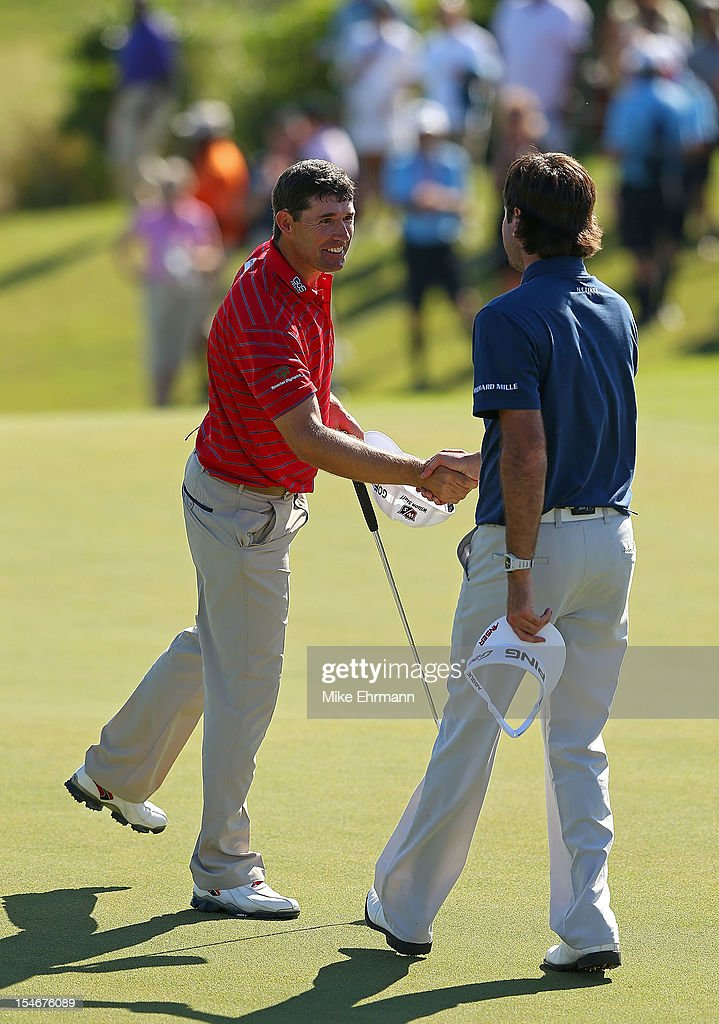 Padraig Harrington of Ireland shakes hands with Bubba Watson after winning on the 18th hole during the final round of the PGA Grand Slam of Golf at Port Royal Golf Course on October 24, 2012 in Southampton, Bermuda.
