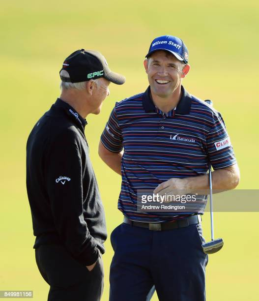 Padraig Harrington of Ireland shares a joke with his coach Pete Cowen during practice for the Portugal Masters at Dom Pedro Victoria Golf Club on...