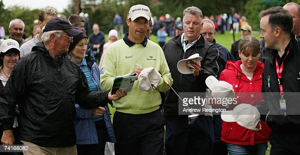 Padraig Harrington of Ireland signs autographs on the ninth hole during the ProAm for the Irish Open on May 16 2007 at the Adare Manor Hotel and Golf...